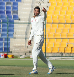 Ahmed Raza celebrates after taking his first wicket of the match