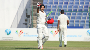 Asghar Stanikzai holds up four fingers after scoring his fourth century of the current Intercontinental Cup competition