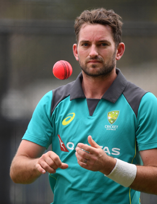 Chadd Sayers prepares to bowl during a training session