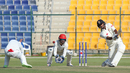 Nasir Jamal takes evasive action as Amjad Javed drives a boundary over cover, UAE v Afghanistan, 2015-17 Intercontinental Cup, 3rd day, Abu Dhabi, December 1, 2017