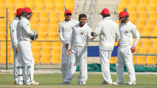 Zahir Khan gets congratulated for taking one of his three wickets