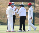 Umpire Ahsan Raza has a word with Afghanistan captain Asghar Stanikzai about his team's behavior, UAE v Afghanistan, 2015-17 Intercontinental Cup, 3rd day, Abu Dhabi, December 1, 2017