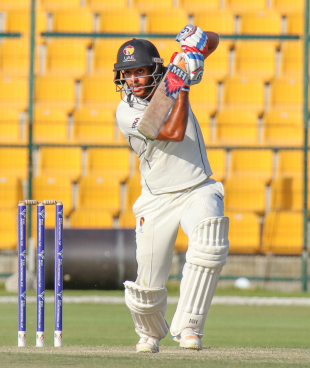 Chirag Suri punches through the off side during his maiden first-class fifty