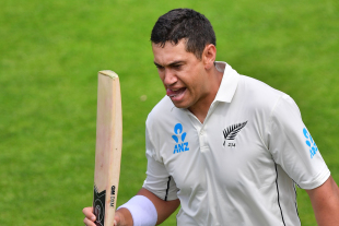 Ross Taylor walks back to the pavilion after falling seven runs short of a century