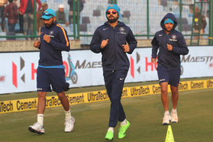 Mohammed Shami, Virat Kohli and Kuldeep Yadav warm-up before the match