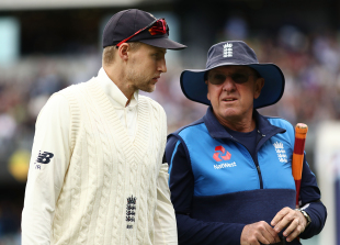 Joe Root and Trevor Bayliss have a word before play begins