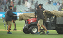 Ground staff hurry to get the square covered following showers, Australia v England, 2nd Test, The Ashes 2017-18, 1st day, Adelaide, December 2, 2017