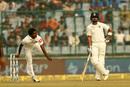 Lakshan Sandakan sends down a delivery as Virat Kohli looks on, India v Sri Lanka, 3rd Test, Delhi, 1st day, December 2, 2017