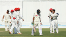 Rashid Khan gets hugs after bowling Muhammad Usman, UAE v Afghanistan, 2015-17 Intercontinental Cup, 4th day, Abu Dhabi, December 2, 2017