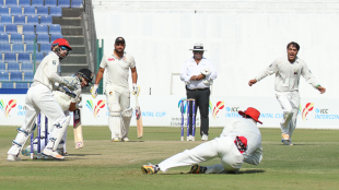Mohammad Nabi holds on to a catch at slip to give Rashid Khan his third wicket on the way to his fourth five-wicket haul