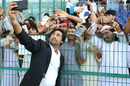 Captain Asghar Stanikzai celebrates by taking selfies with the fans, UAE v Afghanistan, 2015-17 Intercontinental Cup, 4th day, Abu Dhabi, December 2, 2017