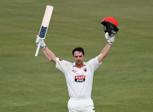 Travis Head celebrates his sixth first-class century