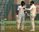 Dinesh Chandimal and Virat Kohli had an animated chat after the Sri Lanka physio was summoned onto the field, India v Sri Lanka, 3rd Test, Delhi, 3rd day, December 4, 2017