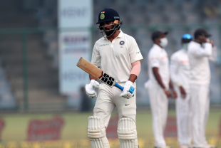 Murali Vijay walks back after edging to Niroshan Dickwella