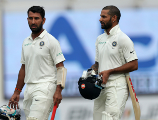 Cheteshwar Pujara and Shikhar Dhawan walk off
