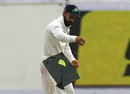 Virat Kohli deals with a stray kite on the field, India v Sri Lanka, 3rd Test, Delhi, 5th day, December 6, 2017