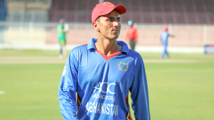 Mujeeb Zadran wanders back to fine leg in between overs of his opening spell