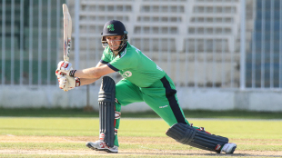 William Porterfield drives through cover for a boundary