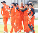 Vivian Kingma gets mobbed by team-mates after taking a hat-trick, Namibia v Netherlands, 2015-17 WCL Championship, Dubai, December 8, 2017