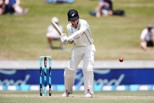 Kane Williamson gets behind the line of a delivery
