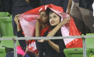 Two spectators take cover in Mirpur after rain stopped play