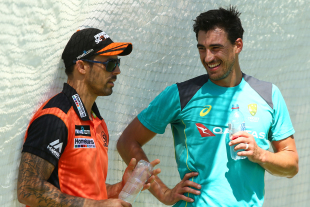 Mitchell Johnson has a chat with Mitchell Starc during a nets session at the WACA