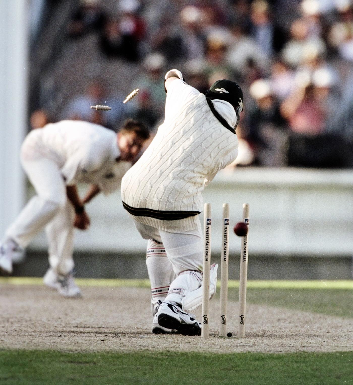Stuart MacGill is bowled by Darren Gough