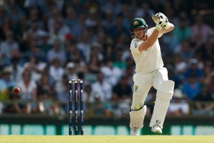 Steven Smith punches with a high elbow
