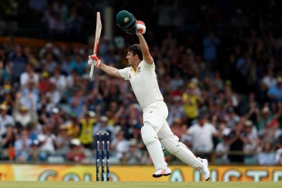 Mitchell Marsh wheels away after scoring his maiden Test ton