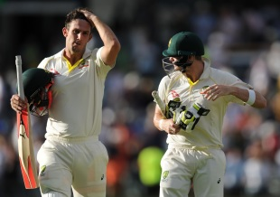 Mitchell Marsh and Steven Smith walk back after an exhausting day