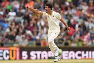 Mitchell Starc celebrates the wicket of James Vince