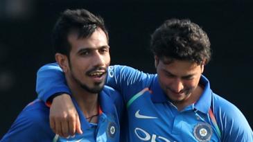 Kuldeep Yadav and Yuzvendra Chahal share a light moment on the field