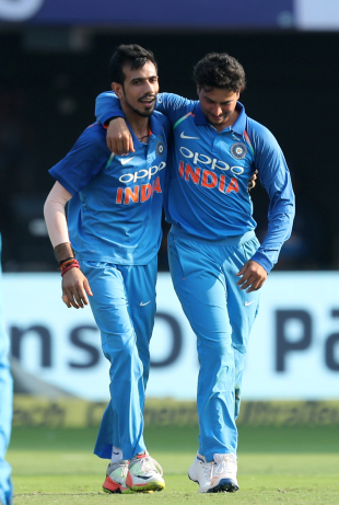 Kuldeep Yadav and Yuzvendra Chahal share a light moment on the field
