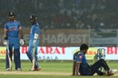 Shikhar Dhawan and Dinesh Karthik look on as Thisara Perera takes a fall, India v Sri Lanka, 3rd ODI, Visakhapatnam, December 17, 2017