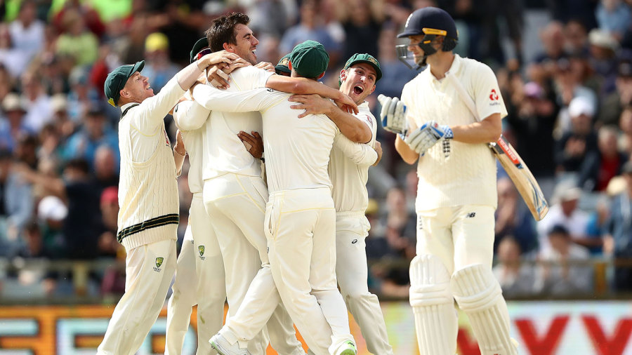 Winning moment: Australia celebrate as Pat Cummins takes the Ashes-clinching wicket