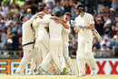 Winning moment: Australia celebrate as Pat Cummins takes the Ashes-clinching wicket , Australia v England, 3rd Test, Perth, 5th day, December 18, 2017