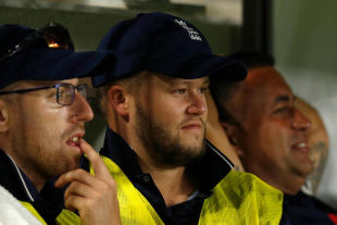 Ben Duckett (centre) watches from the bench during England Lions T20 match against Perth Scorchers