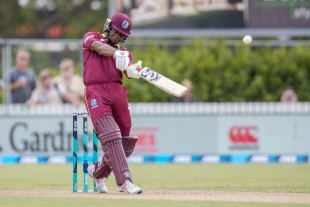 Evin Lewis slices the ball over mid off