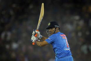 MS Dhoni watches the ball race away