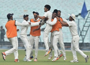 Rajneesh Gurbani is mobbed by his team-mates
