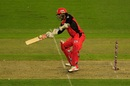 Tom Cooper shapes to scoop the ball over the keeper's head, Melbourne Renegades v Brisbane Heat, BBL 2017-18, Docklands, December 23, 2017