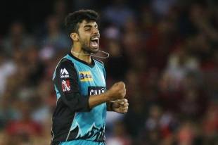 Shadab Khan roars after taking a wicket
