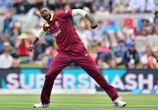 Jason Holder celebrates a wicket