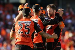 Andrew Tye celebrates the wicket of Luke Wright