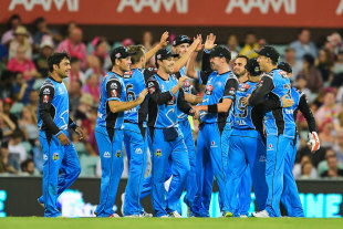 Adelaide Strikers players celebrate a wicket