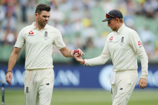 James Anderson and Joe Root inspect the ball