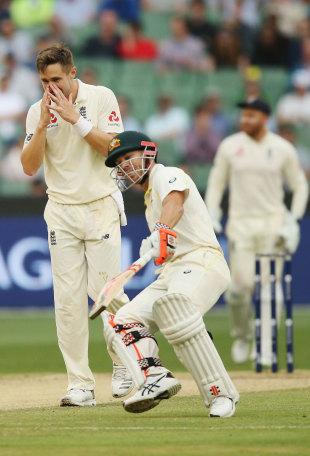 Chris Woakes reacts as David Warner spoons one over midwicket