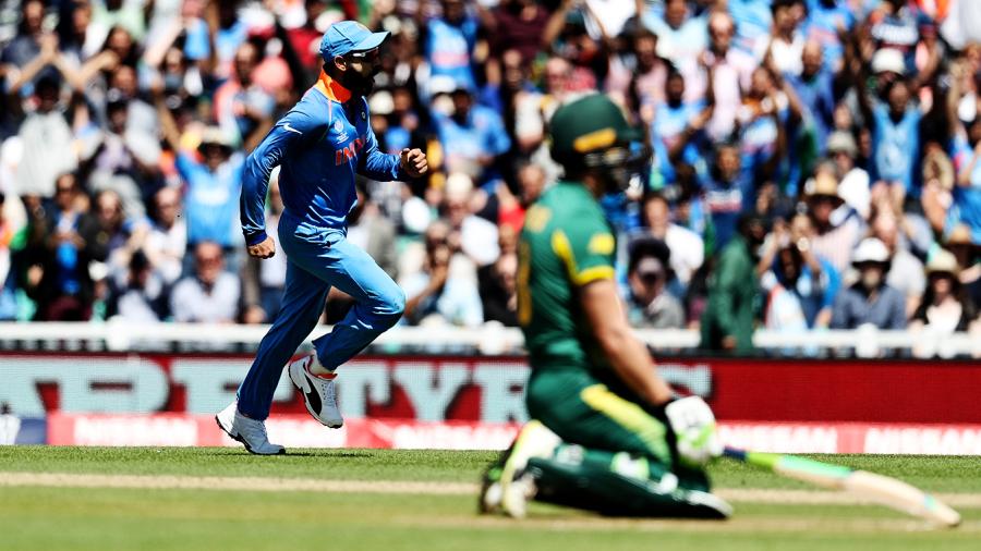 Virat Kohli celebrates running out David Miller
