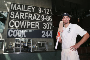 Alastair Cook poses with his name up on the wall at the MCG's Percy Beames Bar