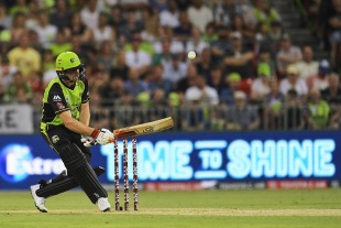 Jos Buttler shuffles across the stumps and plays a scoop